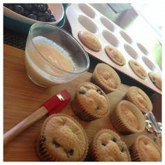 Paleo Blueberry Lemon Muffins Recipe Desserts with large eggs, coconut oil, coconut sugar, lemon extract, lemon zest, sea salt, baking soda, baking powder, almond meal, fresh blueberries, coconut cream, lemon, raw honey