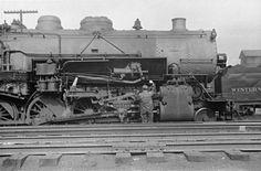 The Rail Road in Elkins. WV   Crewman oils a steam locomotive in the Elkins yard, Elkins, WV, 1939.