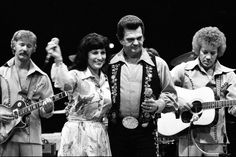 See all the old country songs (and more modern melodies that are legends in the making) that made our playlist. From Hank Williams and Johnny Cash to Dolly Parton and Garth Brooks, here are some of our favorite classic country songs over the decades. Old Country Songs, Classic Country Songs, Country Western Singers, Country Music Stars, Conway Twitty, 70s Tv Shows, Loretta Lynn, Garth Brooks, Country Women