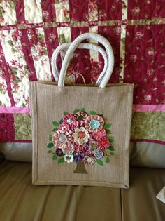 A pretty bag decorated with yo-yo flowers.