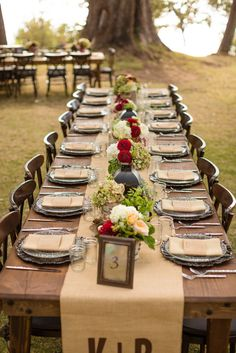 DIY Ideas For a Fall Wedding Tablescape: Everything about this table was perfection! We love how this wedding used mason jars as wine glasses and placed flowers among tabletop lanterns. A monogrammed table runner offered a special touch.   Photo by Marcel and Meher Photography via Style Me Pretty