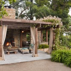 I love a pergola with outdoor curtains! I would make this a two FP and the pergola an extension off our back patio. Outdoor Curtains, Outdoor Rooms, Outdoor Living, Outdoor Decor, Outdoor Kitchens, Outdoor Pergola, Outdoor Photos, Privacy Curtains, Outdoor Seating