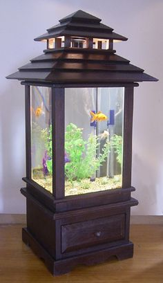 Custom-made wooden fish tank with Bali-style roof.