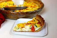 Gluten free, dairy free, paleo quiche with smoked salmon, zucchini, squash and tomatoes with a almond flour rosemary and garlic crust from @AltAprons