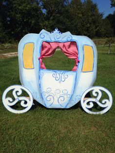 Cinderellas carriage. Made from wood and hand painted. Paink burlap curtains. Perfect for children to sit behind for pictures at theme birthday party.