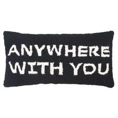 Hand-hooked wool pillow with block lettering.      Product: PillowConstruction Material: Wool cover and polyester fillColor: Black and whiteFeatures: Insert includedDimensions: 9 x 18Cleaning and Care: Spot clean