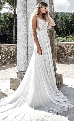 Stunning spaghetti strap side cut-out wedding dress with draped pleated skirt; Featured Dress: Solo Merav