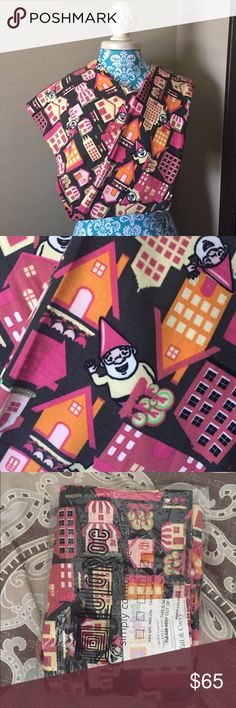 **UNICORN** LuLaRoe Gnome in a Village TC Leggings TC NWT Gnome Leggings. The background is black, and the village/houses are pinks, oranges, yellows, and a little bit of green. Bright, FUN fabric that is thick and buttery like you trust LLR to be. LuLaRoe Pants Leggings