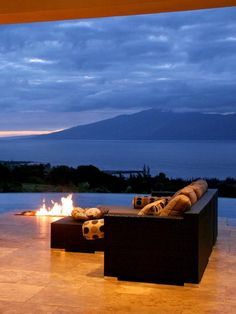 #HouseHunters Faves: Watch the sun set over the Pacific from this Maui, Hawaii, home, where a sunken fire pit and patterned pillows create a cozy atmosphere. The modern style and clean lines also produce a simple and understated elegance without detracting from the breathtaking view.