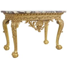 A George II marble-topped giltwood console. | From a unique collection of antique and modern console tables at http://www.1stdibs.com/furniture/tables/console-tables/