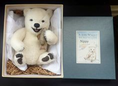 This is one of the most adorable little polar bear soft toys that you can find. It is just gorgeous and made to the very highest of standards, and is from R. John Wrights Baby Bear Collection, America (made exclusively for Campbells Collectibles) - and is the little baby Nippy issue.  He is a carefully observed wee bear with true-to-life details. He has joined arms and head, and made from the very finest white mohair and wool. His features are made with airbrush shading - with a cute molded…
