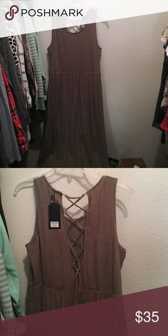 Dottie Couture maxi dress This maxi dress is in the color olive and has a lace up back. Never been worn! Dottie Couture Dresses Maxi
