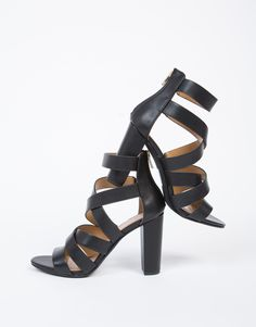 These Criss Cross Block Heels can be dressed up or down. Comes in a stone gray or black color of your choice. Pair these sandal heels with a cold shoulder blouse and wide bow tie harem pants.