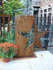 beautiful mix of art and flora in a small gem of an urban garden, Saugatuck, MI