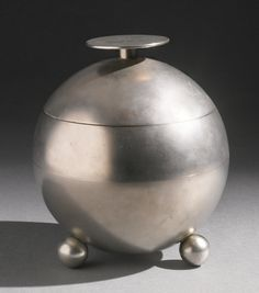 Naum Slutzky AN EXTREMELY RARE LIDDED JAR impressed with the artist's cipher nickel-plated brass 6 1/8  in. (15.6 cm) high 5 1/2  in. (14 cm) diameter circa 1930