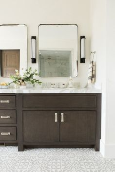 espresso wood custom vanity with cement tile floor for any dream bathroom. Hang Wall sconces between mirrors for that spa-like look