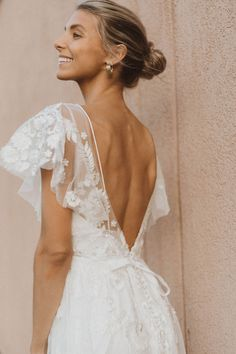 A scattering of floral embroidery and delicate flutter sleeves make this fit-and-flare gown a bohemian dream. Choose from timeless ivory embroidery or a rainbow of colorful blooms. Garden Wedding Dresses, Dream Wedding Dresses, Bridal Dresses, Wedding Gowns, Boho Wedding Dress, Look Boho, Groom Outfit, Ivoire, Bridal Boutique