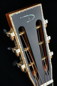 Slotted headstock with Abalone trim of a Driftwood Guitar. www.Driftwood-Guitars.com
