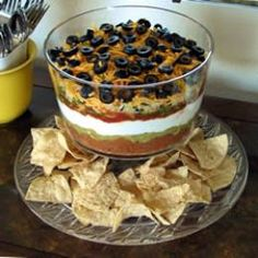 This is a five layer dip and you put refried beans, then guacamole, then sour cream or cream cheese, then salsa, then cheese and then olives on top if you like.   You can even add more layers to it if you want