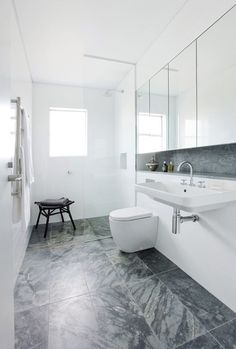 The grey stone effect flooring against white units is a refreshing look that really works. Contemporary Apartment, Contemporary Bathrooms, Small Grey Bathrooms, Apartment Renovation, Mirror Cabinets, Bathroom Interior Design, New Homes, Bathroom Ideas, Bathroom Designs