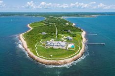 Set at the tip of Mishaum Point, this 10-acre property boasts 1,500 feet of water frontage, a deep-water dock and a stunning 21,000-square-foot shingle-style home.