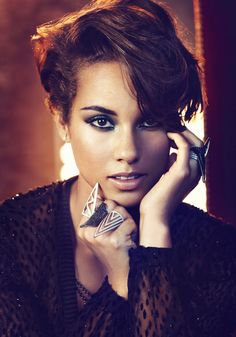 Not an afro, but I like the shape of her haircut. (Alicia Keys)