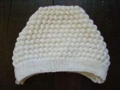 This pattern is from an old 1970s baby pattern book, and makes an adorable, warm, and soft hat.