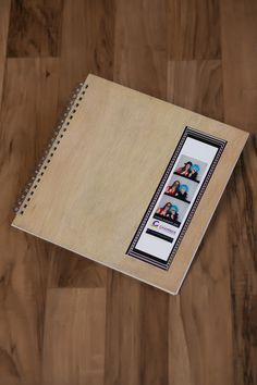 Photo booth wedding guest book. Thin plywood cover with window showing front photo strip. Modern and country chic! zentnerdesign.com