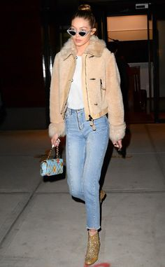 Gigi Hadid from The Big Picture  Glitter girl! The model is spotted rocking gold glitter ankle booties while in New York City.