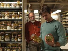 """Steve Rogers, herpetology collections manager (left) and  José Padial, assistant curator of amphibians and reptiles (right), in the """"alcohol house,"""" home to the museum's amphibian and reptile collection. Image credit: Joshua Franzos."""