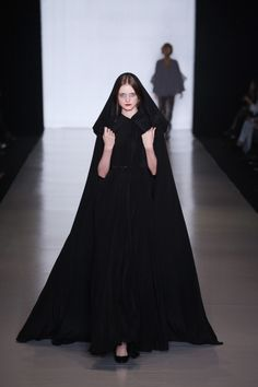 .Long hooded black cloak