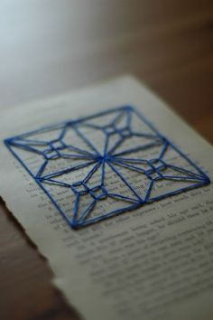 Paper Embroidery Patterns Blue embroidery on vintage book page is included in a round up of stitched paper art by Paper Stitch. Paper Embroidery, Cross Stitch Embroidery, Embroidery Patterns, Embroidered Paper, Doily Patterns, Paper Art, Paper Crafts, Diy Paper, Crazy Quilting