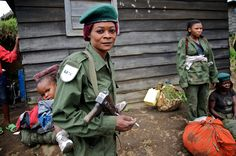 A government soldier carries her infant on her back in eastern Congo.  Tell me *this* image doesn't tell a story.