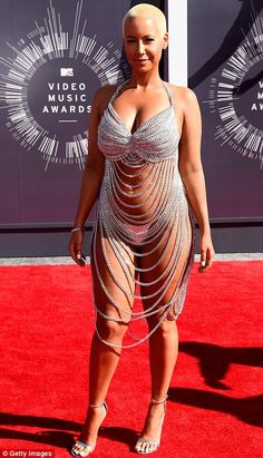 Near naked: Amber Rose showed off much of her voluptuous form in a revealing creation...