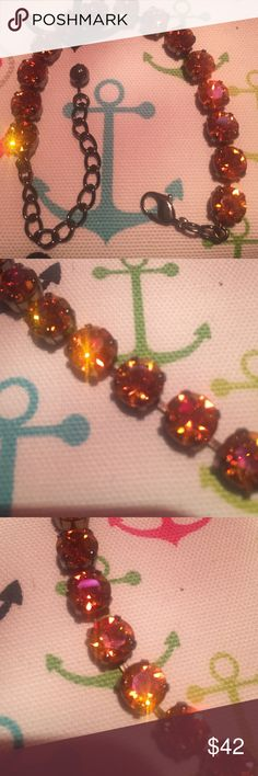 "Swarovski 8mm Crystal Chaton Stone bracelet.. This is a 14 Swarovski crystal Chaton stone bracelet. The stone is summer blush colored. Looks orange but also pink. Stones are set in a hematite bracelet. Total length is 9 1/2"". Swarovski Jewelry Bracelets"