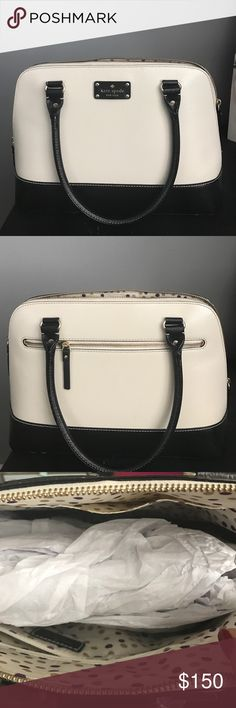 Kate Spade Purse Cream and black leather Kate spade purse in perfect condition except for the black pen mark you can see at the bottom of the inside of the purse. It is shown in the bottom left corner of the picture of the inside. kate spade Bags Shoulder Bags