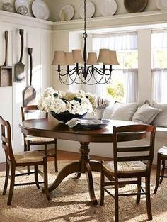 Farmhouse dining room...love the window seat bench as part of the seating for the dining room table.