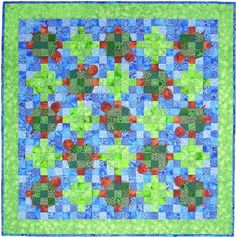 Designed by  Kay Gentry of Noble Needle Quilting & Sewing Turtles are great! They remind us to slow the pace of our busy lives and remain persistent in the long race. These colorful turtles are quietly floating along in a water garden of lily pads. This quilt combines some foundation paper piecing, traditional piecing and a bit of machine appliqué. The background squares can also be die cut using the AccuQuilt Studio or GO! Fabric Cutters.Watch the Video on How to Download PatternsPattern…