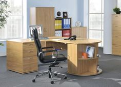 Fantastic Modern Home Office Desk  With Light Brown Wooden Material Some Drawer And Modern Chair Including Gray Carpet Cover Floor And Soft Blue Wall Paint And Drawer Vanity Beside Window Attractive Computer Desk Ideas for Stylish Home Office Decor Interior Design http://seekayem.com