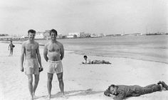 William S. Burroughs takes a nap fully clothed on a beach in Tangier, with Jack Kerouac, centre, and beat poet Peter Orlovsky. Photograph: Allen Ginsberg/Corbis