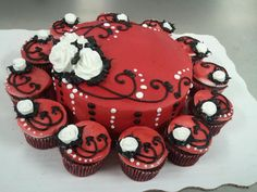 """Birthday Cakes - 8"""" double layer cake and 12 cupcakes in buttercreme icing with red airbrushing, white buttercreme roses and black and white accents."""