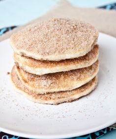 Churros Pancakes - pretty much make a basic pancake recipe, then spread butter on each side of the pancake, then dip each pancake into the cinnamon-sugar mixture coating each side well.