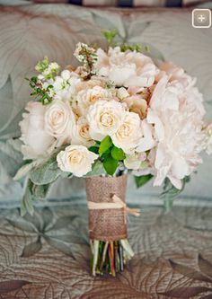 Bridesmaid bouquet - really like this white arrangement =) http://amauiweddingday.com/