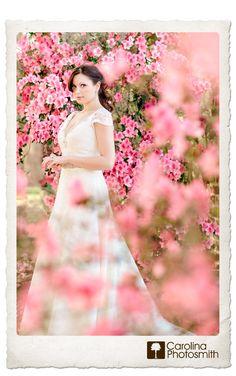 Beautiful bride amid pink azaleas at a Charleston plantation. Timeless, elegant portraits by Carolina Photosmith.
