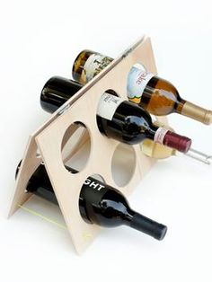 HOW TO MAKE AN A-FRAME WINE RACK. Learn how to make a simple wine rack that brings together the natural wood and neon rope.