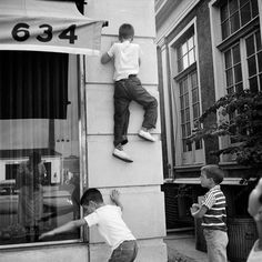 Vivian Maier  -  Chicagoland, No date, (boys climbing) / Silver Gelatin Print  -  12 x 12 (on 16x20 paper)