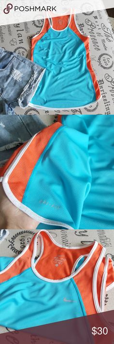 Nike Work/Out /Top Nike running Dri fit tank top in a size XS The tank is turquoise with orange on the sides, see pics. The tank measures 23 inches in length and is 13 1/2 inches across the chest measured laying flat. Mint condition!  Hard to find purchased in Europe! Nike Tops Tank Tops