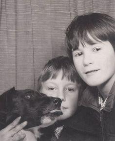 Photobooth photo of 2 boys & their beloved dog.