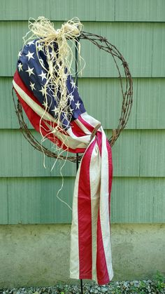 Barbed wire wreath with flag