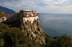 Mount Athos peninsula is the only monastic state in Europe! Enormous monasteries, like castles or fortresses dot the coast and appear on the mountain slopes with every bend in the road.  #Unesco #Athos #Thessaly #Greece #Monterrasol #travel #privatetours #customizedtours #multidaytours #roadtrips #travelwithus #tour #nature #sea art #beautiful #thisisgreece #destination #tourism #beauty #mountains #blue #green #peninsula #greek #orthodox #church #monastery #faith #religion #history… Vladimir Putin, The Holy Mountain, Best Greek Islands, Wild Waters, Inle Lake, Natural Pond, Tourist Trap, Santorini Greece, Greece Travel